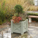 Planted garden container situated on a patio
