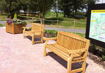 Bespoke wooden benches and planters for Dogs Trust Shrewsbury