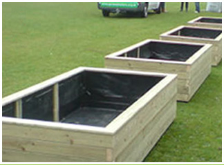 Large wooden vegetable planters with a waterproof lining