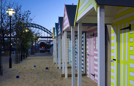 Colourful beach huts in Newcastle
