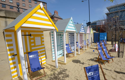 Colourful beach huts and deckchairs