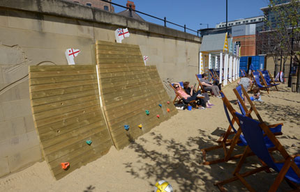 People relaxing on deck chairs at the Quayside Seaside