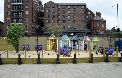 Beach huts, decking and deck chairs at Quayside Seaside