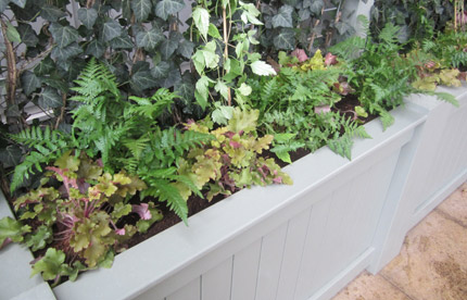 Close up of our painted wooden planters for Waitrose