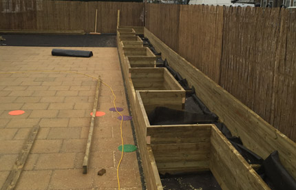 Bespoke wooden planters for a primary school