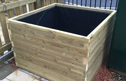 Large wooden planter for Whitehorse Manor Primary
