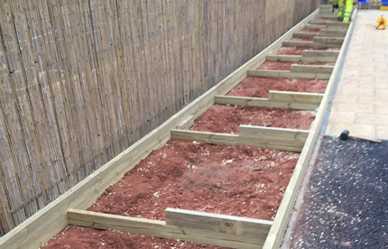 Custom made vegetable troughs with soil