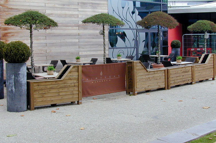 Cafe barrier planters create an outdoor dining area for Palm Sugar Lounge