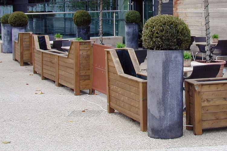 Timber barrier planters for a cafe