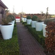Large white tapered planters made from Aluminium