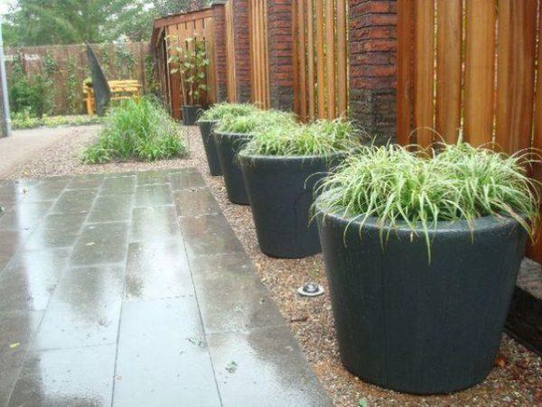 Round black Fibreglass planters