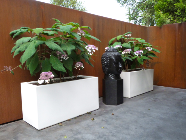 Poulated White garden troughs