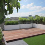 Populated Fibreglass planters on a decking