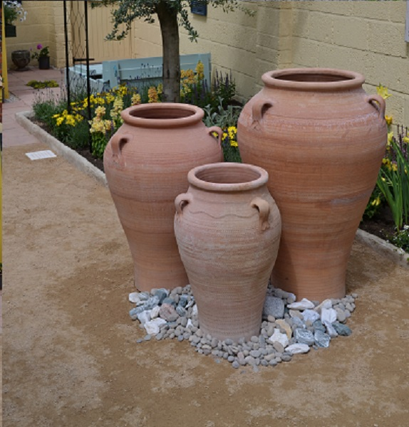 Three sizes of hand-thrown Terracotta plant pots