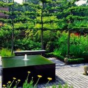 Black water feature in a modern garden