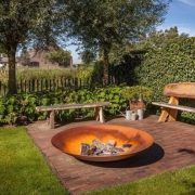 Steel fire bowl in a garden