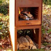 Corten Steel wood burner in a garden