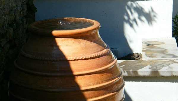 Close up of a steel water feature vase