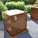 Corten Steel water tables in a garden