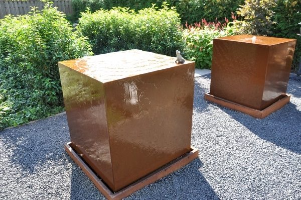 Corten Steel water tables in a garden