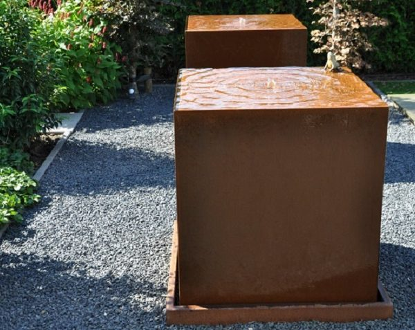 Water rippling over a corten steel block