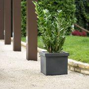 Grey Liscio Plant Pot in a garden